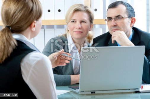 155279487 istock photo Meeting with laptop and three business people 96961663