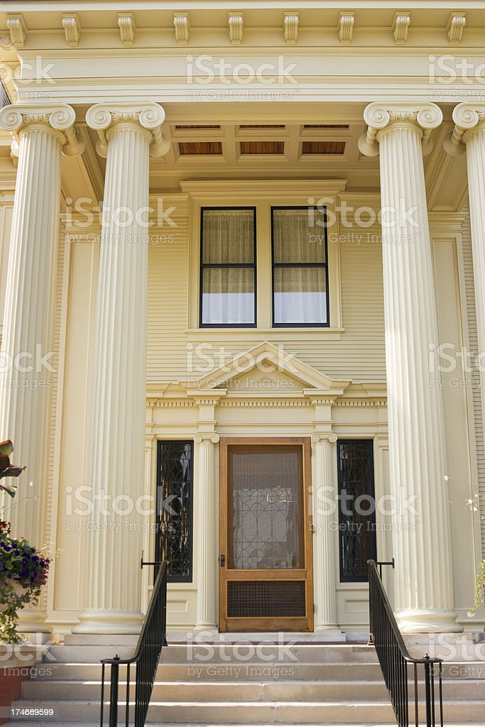 \'Subject: Vertical close-up of the front door entrance of the Cyrus...