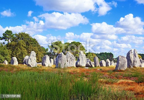 A menhir - Breton meaning stone and hir meaning long - is a megalithic monument composed of a single stone, cut or rough, small or large and placed vertically. Menhirs are also called monoliths. They can be arranged alone or in groups.