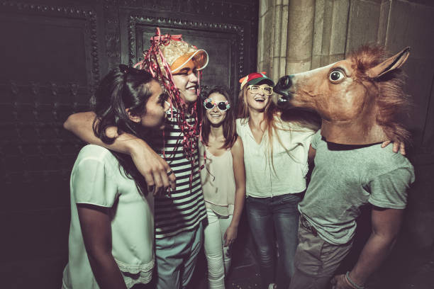 megaparty: friends party wild in the streets - defiance stock pictures, royalty-free photos & images
