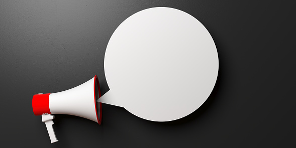 istock Megaphone and blank bubble isolated on black background, copy space. 3d illustration 1094475526