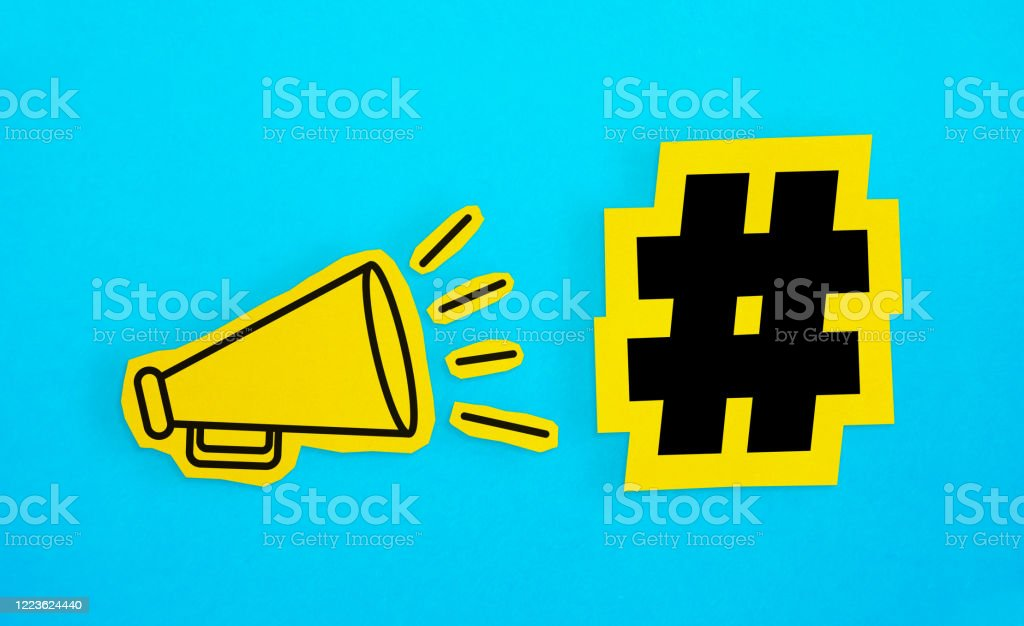 "Megaphone drawing on the cut yellow paper makes ""Hashtag icon"" announcement. Megaphone drawing on the cut yellow paper makes ""Hashtag icon"" announcement. Horizontal composition with copy space. Communication Concept. Abstract Stock Photo"