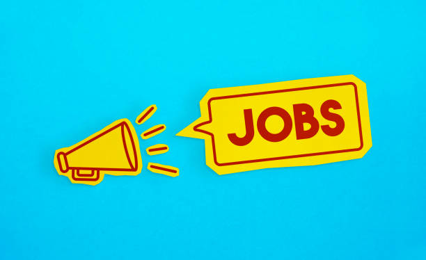 """Megaphone drawing on the cut yellow paper makes """"Jobs"""" announcement. stock photo"""