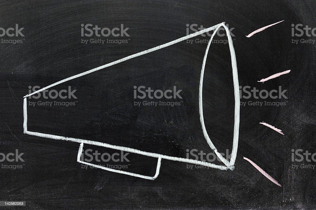 A megaphone drawn in white chalk on a blackboard stock photo