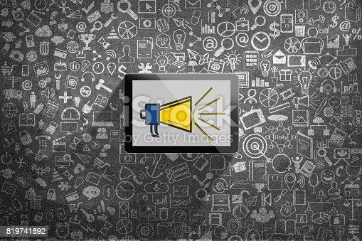 istock Megaphone icon on digital tablet 819741892