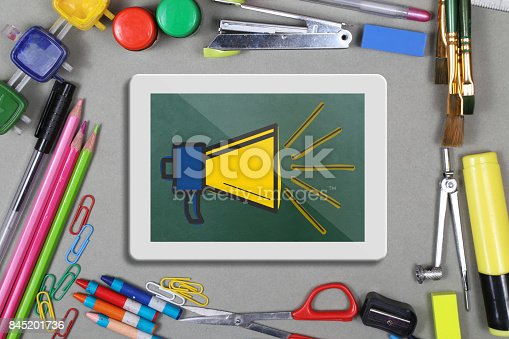 istock Megaphone icon on digital tablet with office supplies 845201736