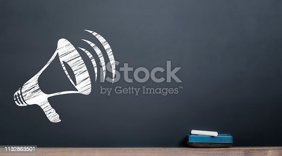 istock megaphone icon on the chalkboard with chalk and eraser 1132863501