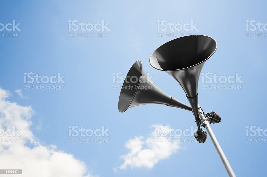 Megaphone loudspeakers standing high up in the air stock photo