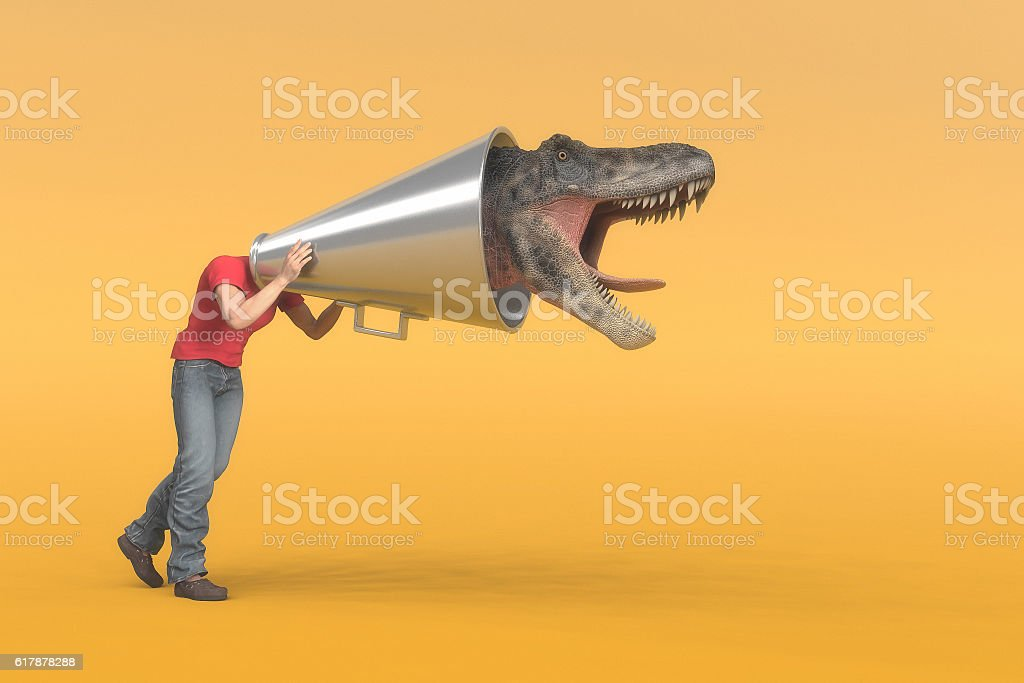 Megaphone man to dinosaur stock photo