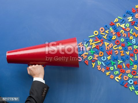 istock megaphone on blackboard with stickers of letters 521773761