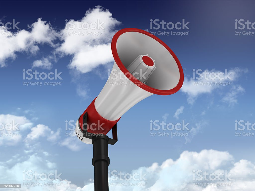 Megaphone on Blue Sky and Clouds Background. stock photo