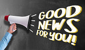 istock megaphone or bullhorn against chalkboard with text GOOD NEWS FOR YOU 1152418511