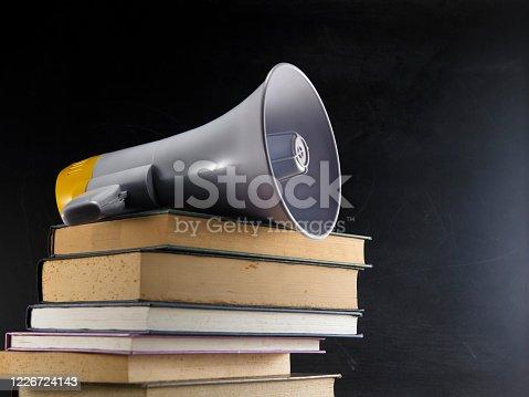 megaphone on stack of books