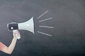 istock Megaphone with woman hand on blackboard 522333454
