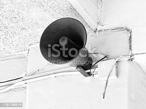 Electric Megaphone or Circular Horn Loudspeaker Hanging on The Wall.