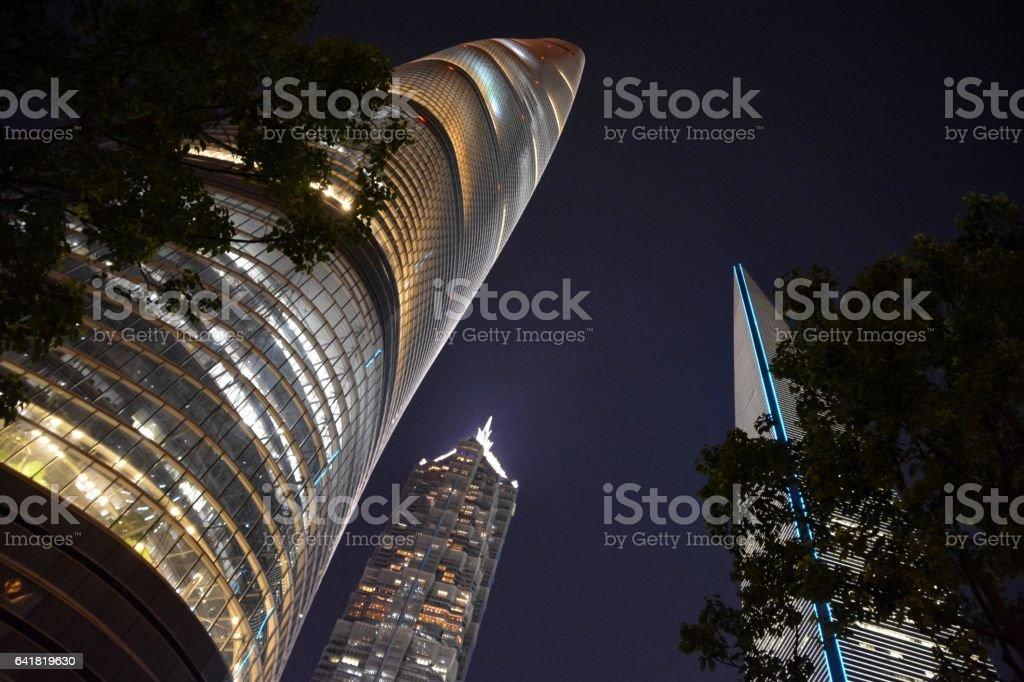 Megatall skyscrapers by night in Lujiazui, Shanghai, China stock photo