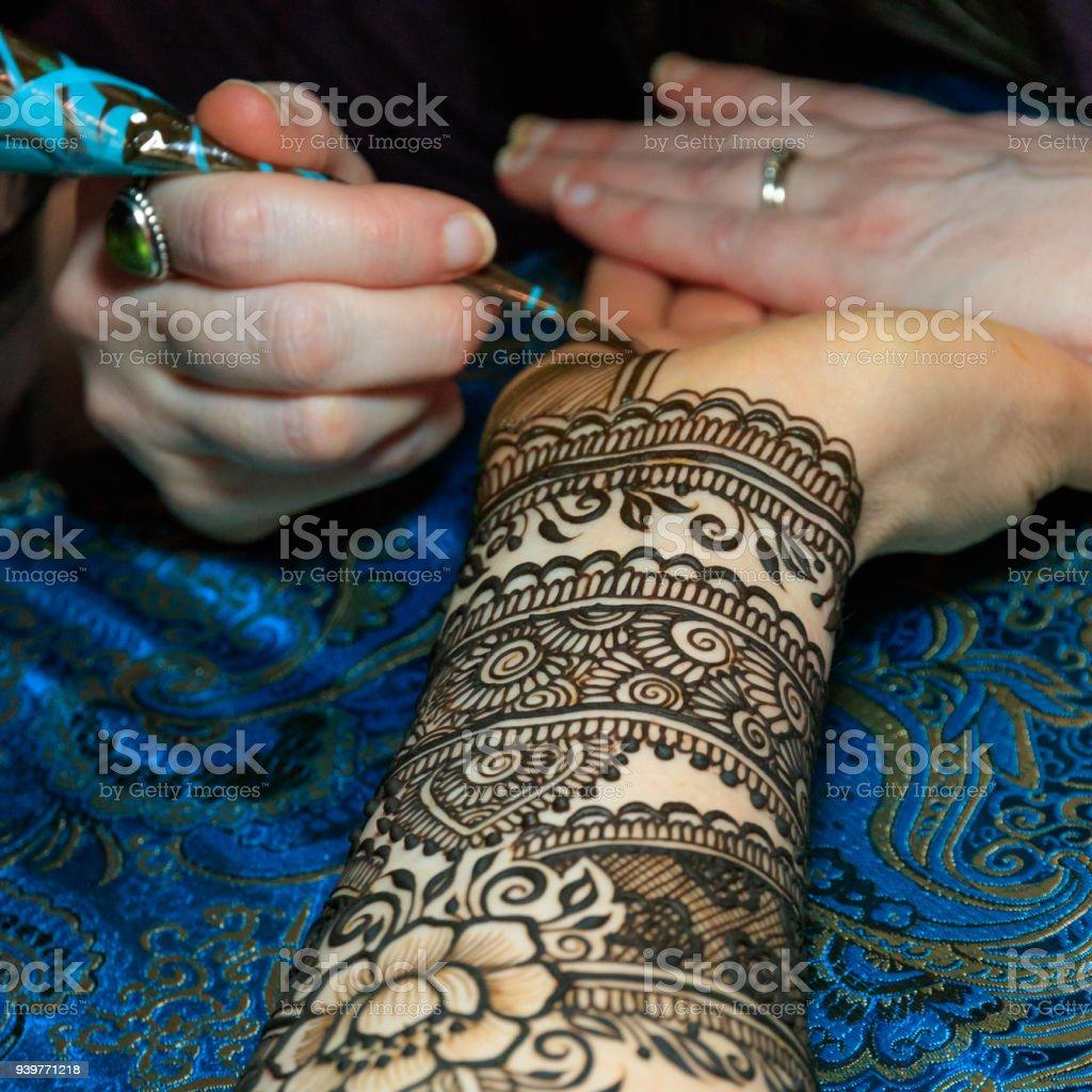 Mehendi (henna) application stock photo