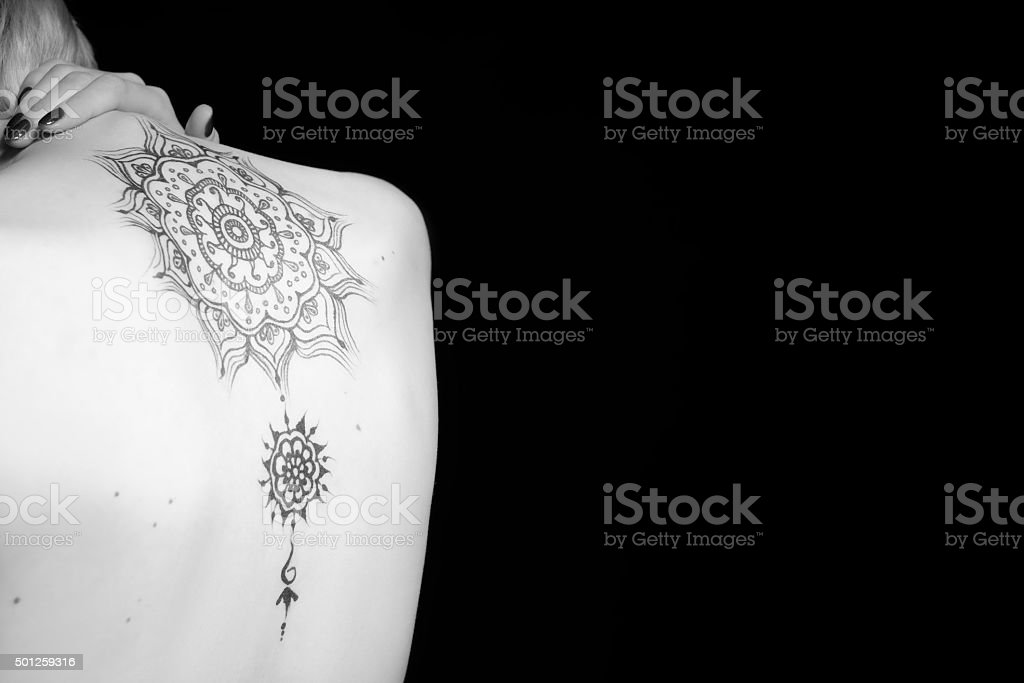Mehendi pattern on the back of a girl stock photo