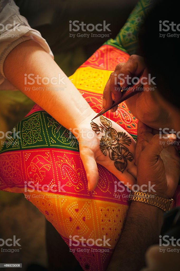 Mehndi or Henna Tattoo Application stock photo