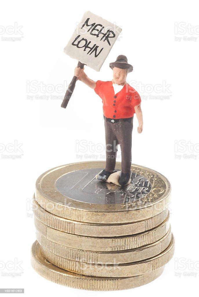 Mehr Lohn - Männchen auf Euromünzen stock photo