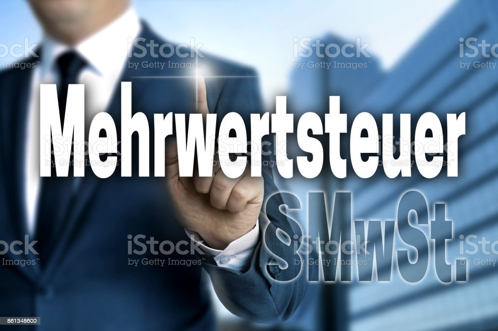 Mehrwertsteuer (in German VAT) touchscreen is operated by business man stock photo
