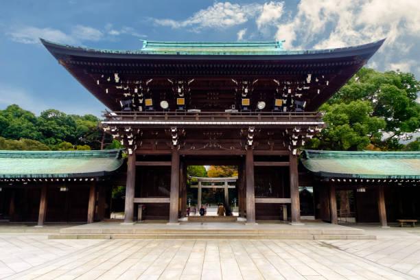 TOKYO - Dec 12: Meiji Jingu Shrine,Tokyo on 12th December 2014. Meiji Jingu Shrin is the Shinto shrine and most popular historical shrine. TOKYO - Dec 12: Meiji Jingu Shrine,Tokyo on 12th December 2014. Meiji Jingu Shrin is the Shinto shrine and most popular historical shrine. shrine stock pictures, royalty-free photos & images