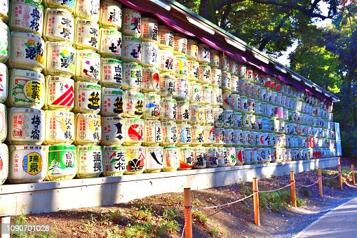 Tokyo, Japan-December 31, 2018: The photo shows many barrels of sake (Japanese rice wine), which were donated to the Shrine by sake makers .   Meiji-jingu Shrine, a Shinto shrine, was established in 1920 and dedicated to Emperor Meiji (1852-1914) and his consort Empress Shoken (1850-1914); the great grandparents of the current Emperor Akihito.  The average number of people to visit Meiji-jingu Shrine during the first three days of New Year is said to be over 3 million, No 1 spot in the whole Japan.