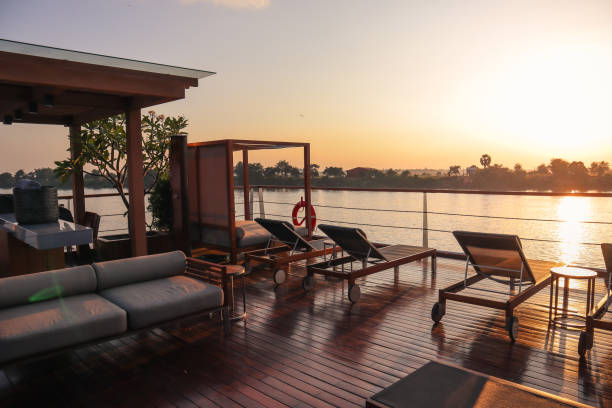 mekong cruise ship deck in sunset - mekong river stock pictures, royalty-free photos & images