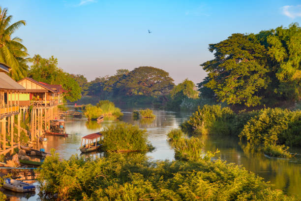 Mekong River 4000 islands Laos, sunrise dramatic sky, mist fog on water, famous travel destination backpacker in South East Asia stock photo