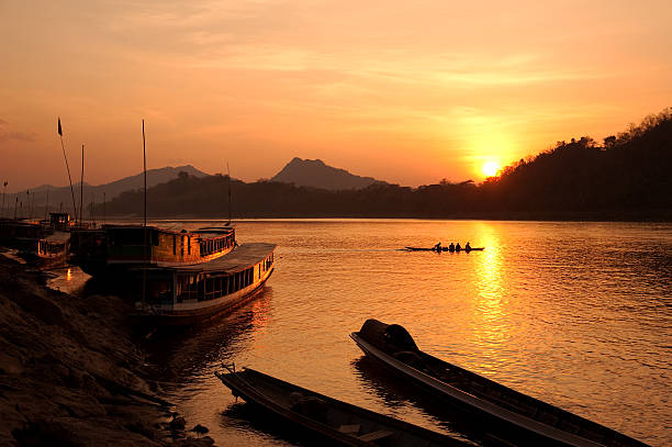 mekong river, located in luang pravang, laos, at sunset - mekong river stock pictures, royalty-free photos & images