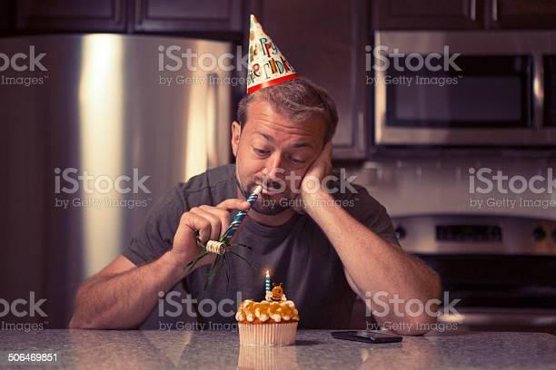 Melancholy man at home celebrating her birthday all alone Melancholy man at home celebrating her birthday all alone Adult Stock Photo