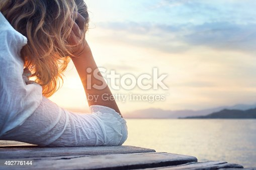 melancony woman observing the sunset