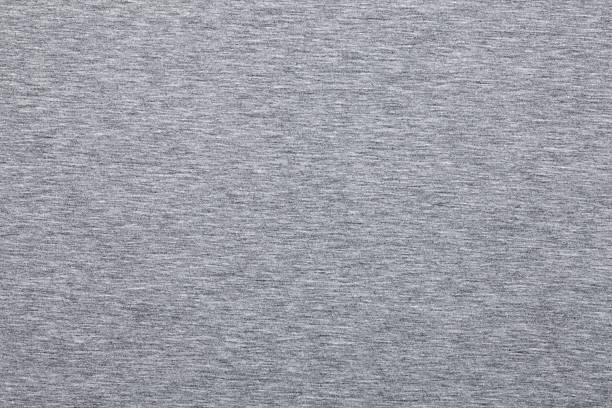 Melange jersey knit fabric pattern Real heather grey knitted fabric made of synthetic fibres textured background heather stock pictures, royalty-free photos & images