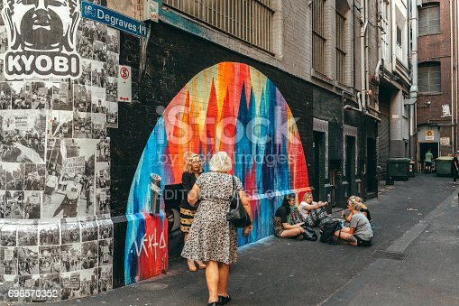 534781401 istock photo Melbourne, AUSTRALIA - March 9 2017: People and ambient at Degraves place laneway, in the city centre of Melbourne, Australia. 696570352
