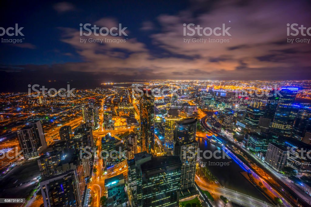 Melbourne city skyline at night with crescent moon stock photo