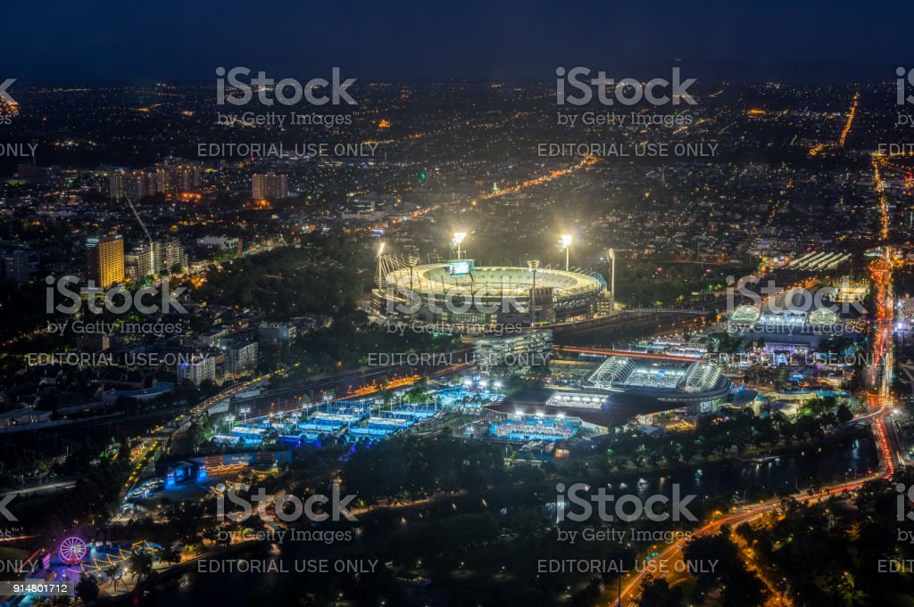 Melbourne Cricket Ground and Yarra Park tennis stadium illuminated at sunset. stock photo
