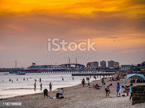 Australia, Melbourne - January 02, 2015: Summer sun setting over Melbourne inner city beach at St Kilda