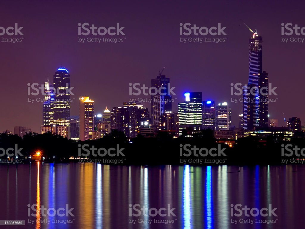 Melbourne skyline reflected on the sea at night royalty-free stock photo