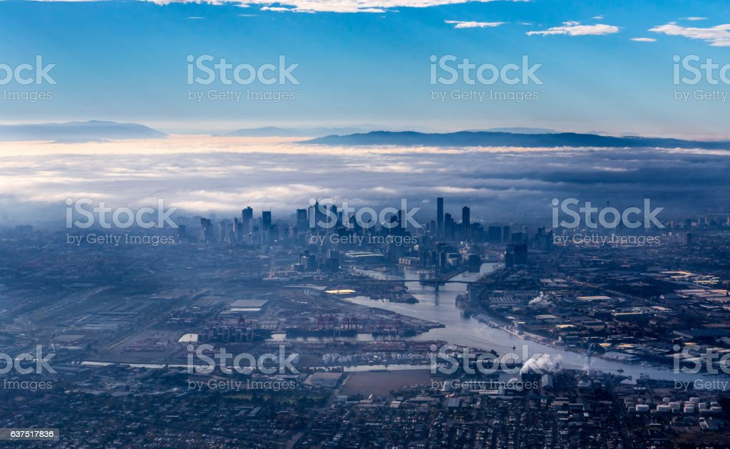 Melbourne skyline with skyscrapers emerging from the morning fog stock photo