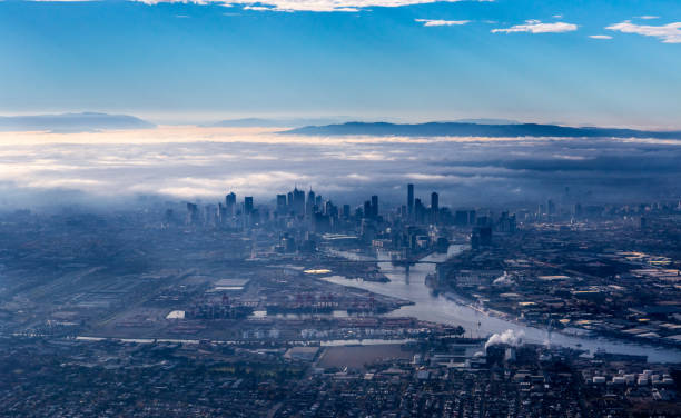 melbourne skyline with skyscrapers emerging from the morning fog - stratosfer stok fotoğraflar ve resimler