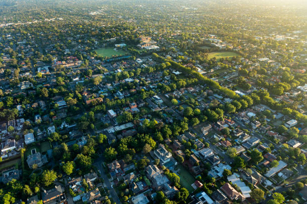 Melbourne suburb in the sunrise Balloon ride from the Melbourne suburbs to the center city urban sprawl stock pictures, royalty-free photos & images