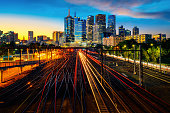 Melbourne train staation with Melbourne city background in sunset, Australia, this immage can use for Melbourne travel and transportation.