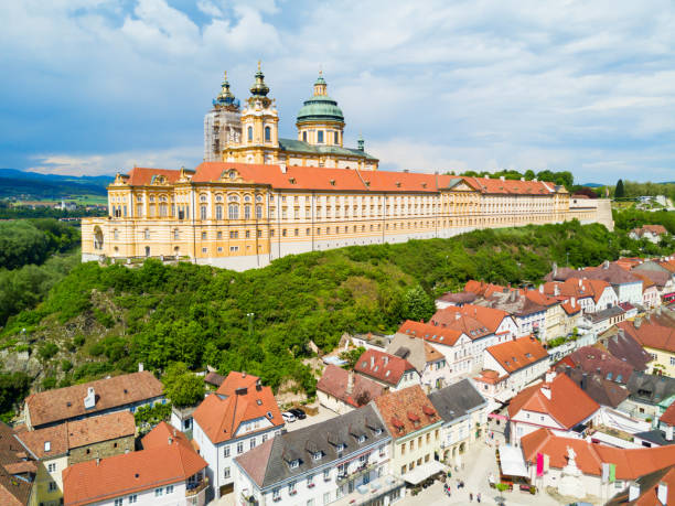 Melk Monastery aerial view Melk Abbey Monastery aerial panoramic view. Stift Melk is a Benedictine abbey in Melk, Austria. Monastery located on a rocky outcrop overlooking the Danube river and Wachau valley. abbey monastery stock pictures, royalty-free photos & images