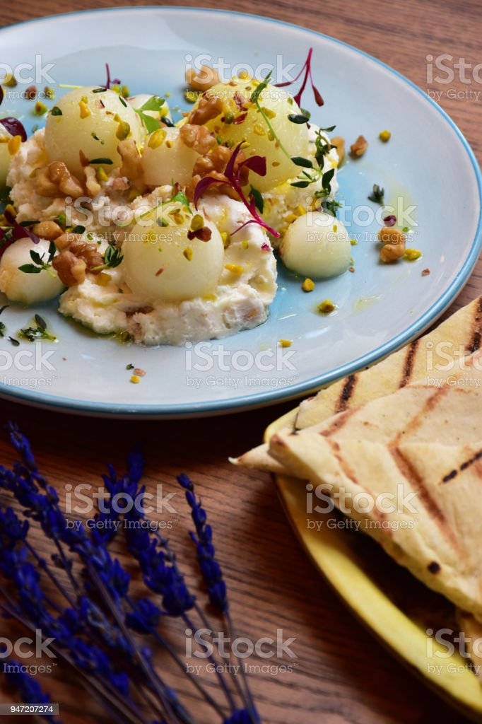 melon and cheese  plate stock photo