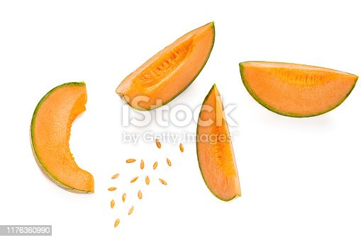 Melon Creative Layout. Fresh sliced cantaloupe Melon fruit isolated  on white background. Flat lay. Top view