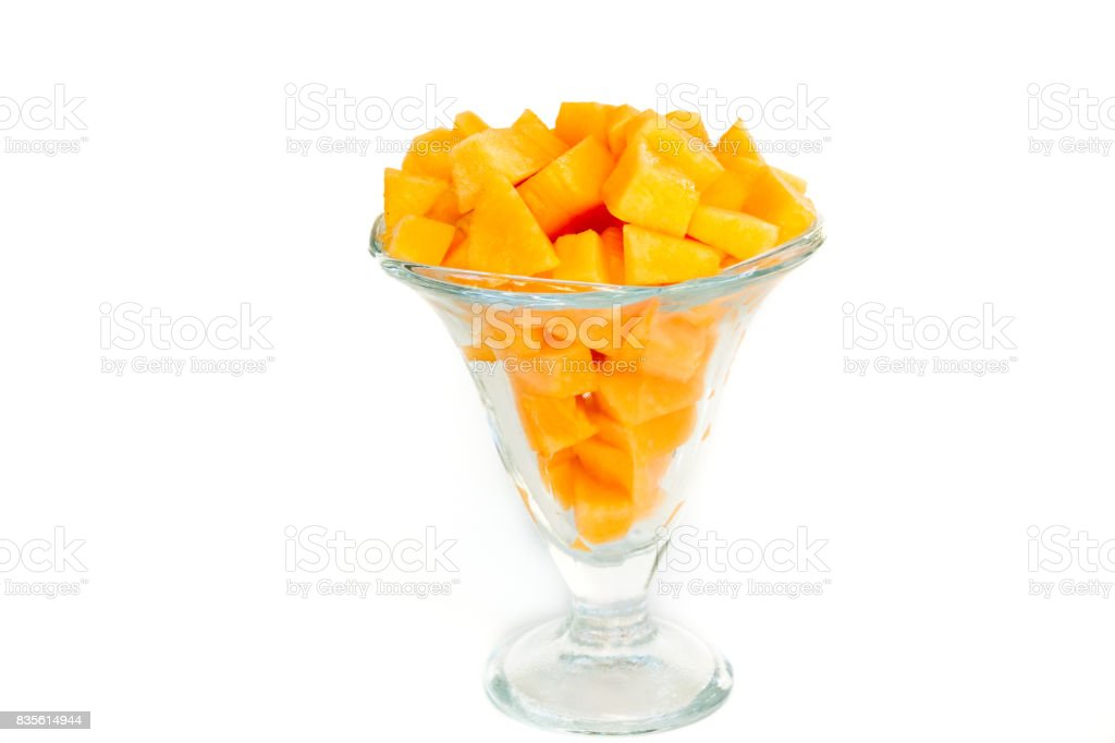 melon cut asunder served in the glass stock photo