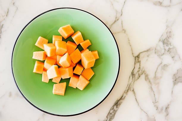 Melon on a glazed plate.