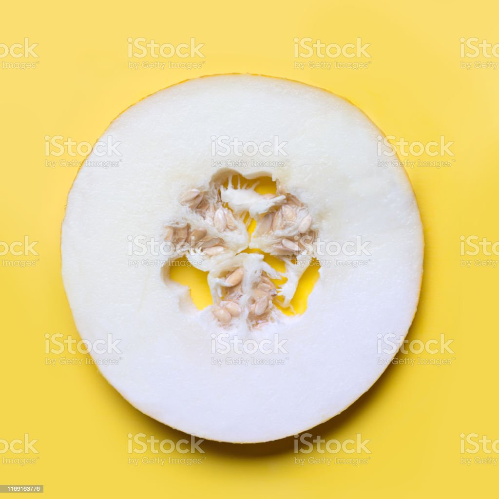 Melon sliced on yellow background. Flat lay. Food concept.