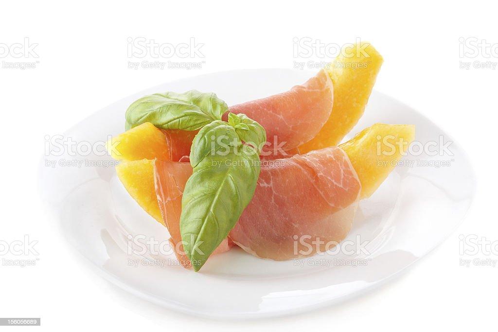 Melon with prosciutto royalty-free stock photo