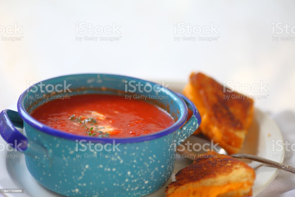 Melted cheese sandwich with tomato soup stock photo